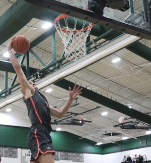 Shelby's TJ Pugh goes up for a one-handed jam as the Whippets remain at No. 1 in the Richland County Boys Basketball Power Poll.