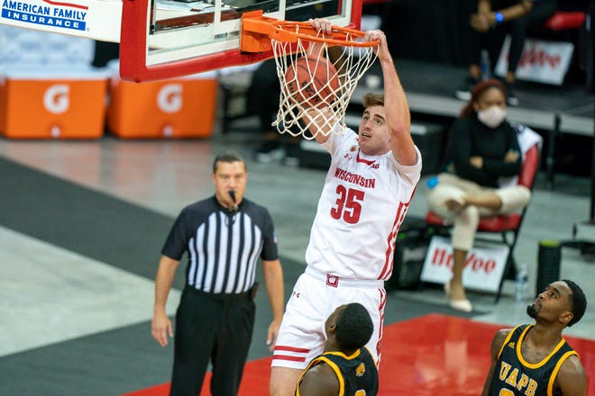UW forward Nate Reuvers throws down a dunk against Arkansas-Pine Bluff during the first half.