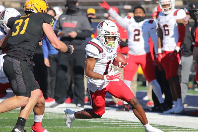 Ball State wide receiver Justin Hall runs with the ball during the Cardinals' game against Toledo. With the win, BSU moved to 3-1.