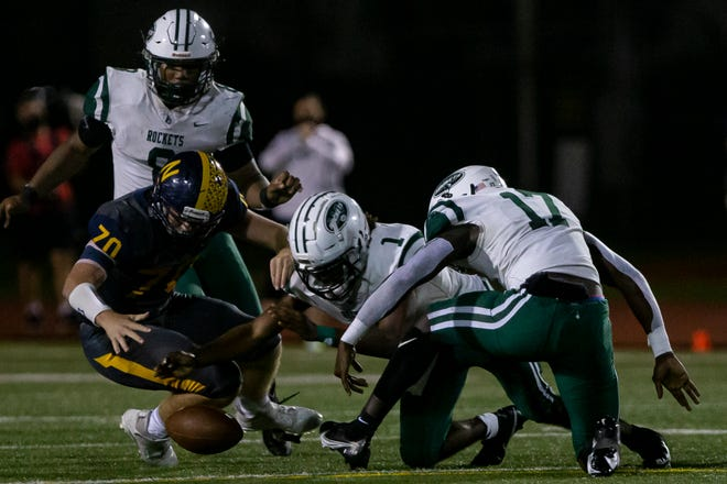 Miami Central linebacker Wesley Bissainthe (17) attempts to scoop up a fumble against Naples in the Region 4-6A semifinals on Nov. 27, 2020 in Naples.