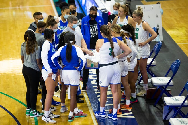 FGCU head coach Karl Smesko talks to his team before a Gulf Coast Showcase game between FGCU and the University of Arkansas held at Alico Arena at FGCU in Fort Myers on Saturday, November 28, 2020.