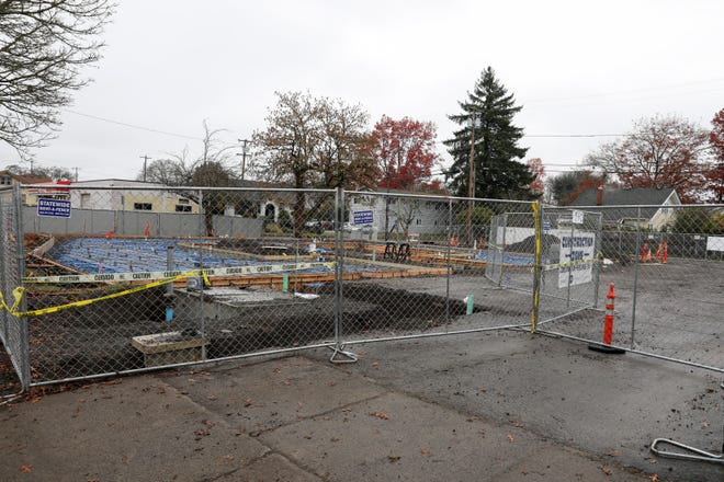 Construction takes place on a mixed-use multi-family and commercial retail building at 990 Broadway St NE, in Salem, Oregon on Saturday, Nov. 28, 2020.