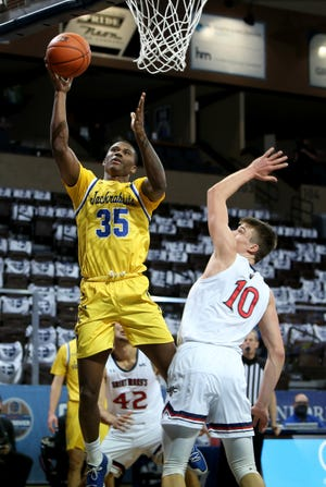 SIOUX FALLS, SD - NOVEMBER 27: Douglas Wilson #35 of the South Dakota State Jackrabbits shoots over Mitchell Saxen #10 of the St. Mary's Gaels during the Bad Boy Mowers Crossover Classic at the Sanford Pentagon in Sioux Falls, SD. (Photo by Dave Eggen/Inertia)