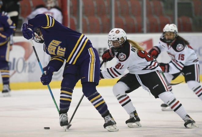St. Cloud State junior Jenniina Nylund battles for the puck against MSU-Mankato Friday, Nov. 27, 2020, at Herb Brooks National Hockey Center.