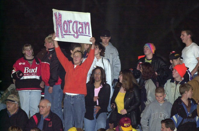 Morgan fans cheer on the football team during a Division III, Region 11 playoff game against visiting Millersburg West Holmes during the 2000 season in McConnelsville. The Raiders finished 10-0 and ranked No. 2 in the Associated Press poll.