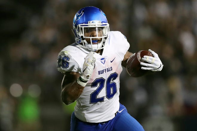 Buffalo running back Jaret Patterson rushed for 409 yards and eight touchdowns in Saturday's victory over visiting Kent State.