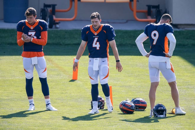 Broncos quarterbacks (from left) Drew Lock, Brett Rypien and Jeff Driskel take part in training camp at the UCHealth Training Center in Englewood, Colorado.