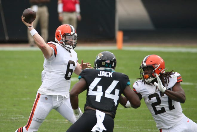 Cleveland Browns quarterback Baker Mayfield (6) throws a pass over Jacksonville Jaguars linebacker Myles Jack (44) during the first half of an NFL football game, Sunday, Nov. 29, 2020, in Jacksonville, Fla. (AP Photo/Stephen B. Morton)