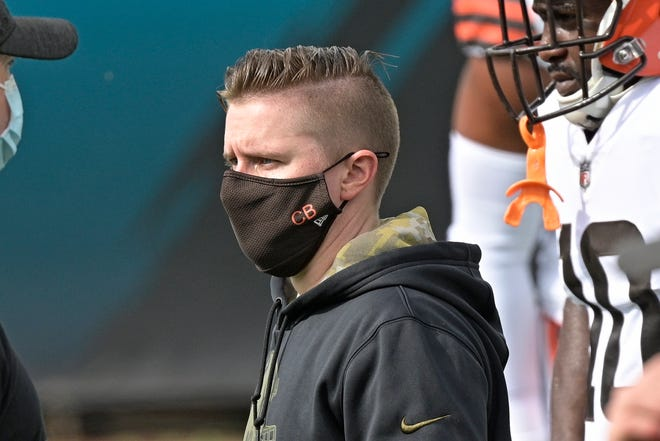 Browns coach Callie Brownson watches players warm up before an NFL football game against the Jacksonville Jaguars, Sunday, Nov. 29, 2020, in Jacksonville, Fla. [Phelan M. Ebenhack/Associated Press]