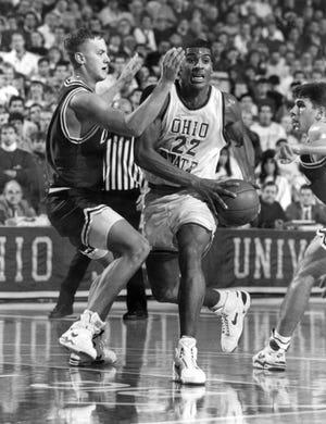 Jim Jackson drives against Ohio's Steve Ehretsman during a game on Dec. 5, 1991.