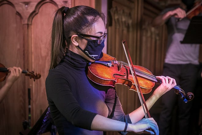 """Violinist Emma Powell is one of the musicians performing in the Cape Cod Chamber Orchestra's """"Songs of Midwinter"""" concert."""