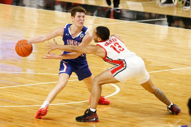 UMass-Lowell's Bryce Daley keeps the ball away from Ohio State's C.J. Walker during the second half on Sunday in Columbus, Ohio.
