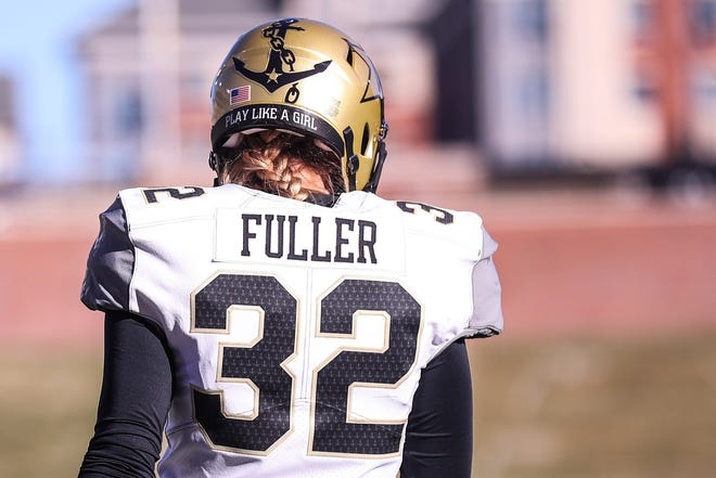 Vanderbilt kicker Sarah Fuller (32) became the first woman to play in a football game for aPower Five program Saturday against Missouri at Faurot Field.