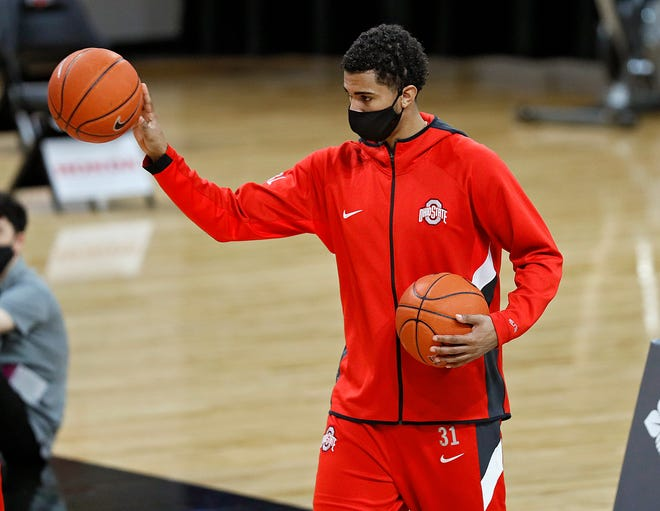 Ohio State forward Seth Towns passes basketballs during warm-ups for a game against UMass Lowell on Sunday.