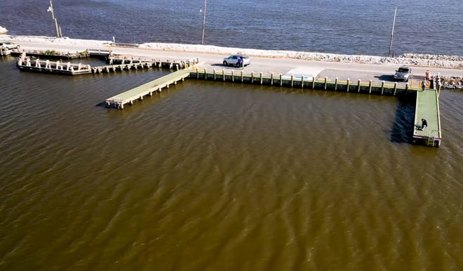 One of the five fishing piers built along Island Road, each with two sections that extend over the water, is shown in an image from a video by the Louisiana Coastal Protection and Restoration Authority.