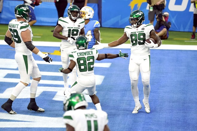 New York Jets tight end Chris Herndon (89) celebrates with teammates after making a touchdown catch against the Los Angeles Chargers Nov. 22, 2020, in Inglewood, California.