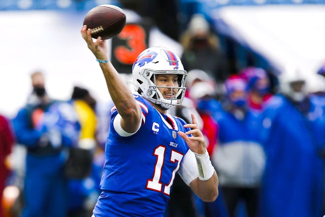 Buffalo Bills quarterback Josh Allen throws a pass during a Nov. 1 game against the New England Patriots in Orchard Park, New York. Allen and the AFC East-leading Bills prepare to host the rookie Justin Herbert-led Chargers on Sunday in a showdown of the NFL's two leaders in passing yards.