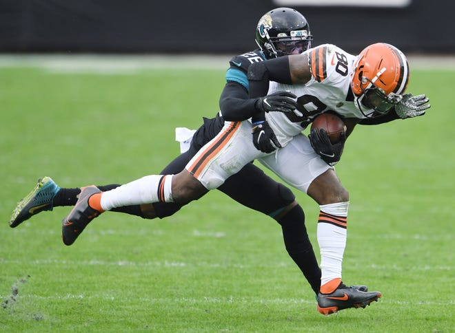 Jaguars safety Jarrod Wilson tries to bring down Cleveland's Jarvis Landry during a game last season at TIAA Bank Field.