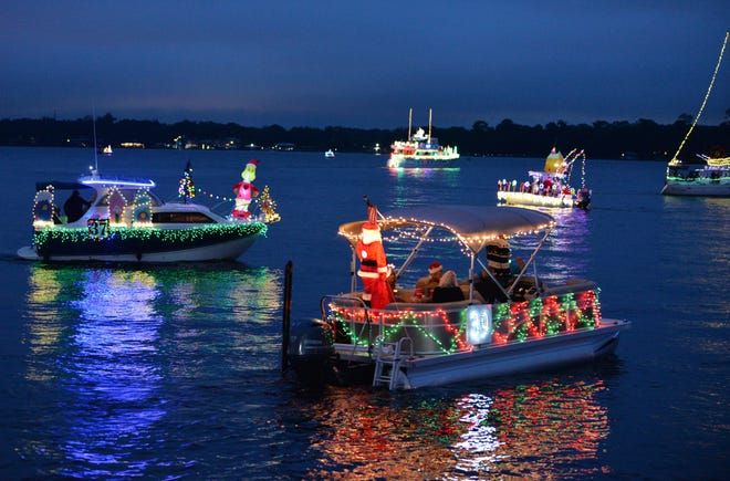 Boats decked their hulls and kicked off the holiday season on the St. Johns River as thousands of spectators viewed Jacksonville's annual Light Boat Parade on Saturday night.