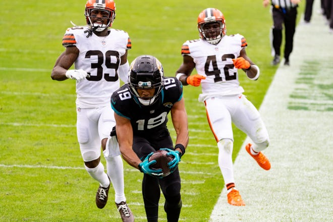Jaguars wide receiver Collin Johnson dives into the end zone for a touchdown on Sunday during the second quarter against the Cleveland Browns, at TIAA Bank Field.