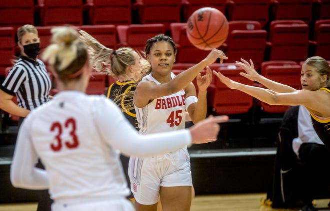 Bradley's Nyjah White (45) passes the ball in traffic in the first half Saturday, Nov. 28, 2020 at Renaissance Coliseum. The Braves fell to the Milwaukee Panthers 65-60.