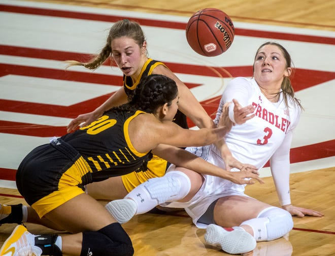 Bradley's Gabi Haack (3) tangles with Milwaukee's Kendall Nead (30) and McKaela Schmelzer in the first half Saturday, Nov. 28, 2020 at Renaissance Coliseum. The Braves fell to the Milwaukee Panthers 65-60.