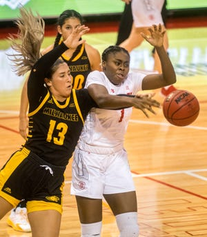 Milwaukee's Brandi Bisping (13) and Bradley's Tete Danso battle for a rebound in the second half Saturday, Nov. 28, 2020 at Renaissance Coliseum. The Braves fell to the Milwaukee Panthers 65-60.
