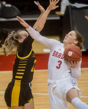 Bradley's Gabi Haack, right, fends off Milwaukee's Bre Cera in the second half Saturday, Nov. 28, 2020 at Renaissance Coliseum. The Braves fell to the Milwaukee Panthers 65-60.