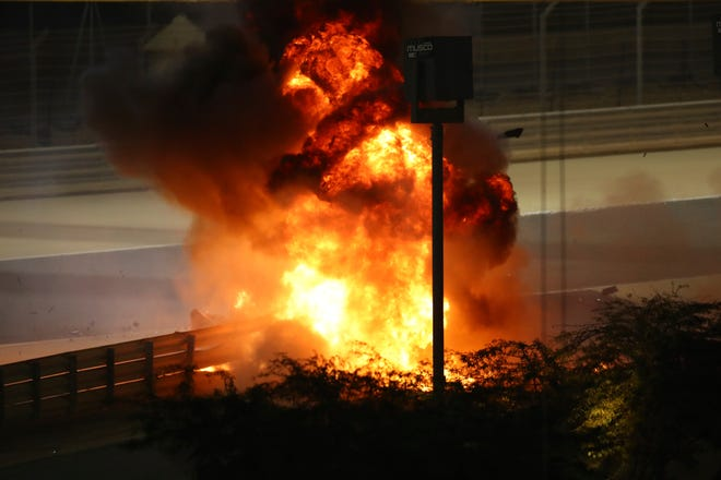 Flames pour from the scene after Haas driver Romain Grosjean of France crashed out at the start of the Formula One race in Bahrain International Circuit in Sakhir, Bahrain, on Sunday.