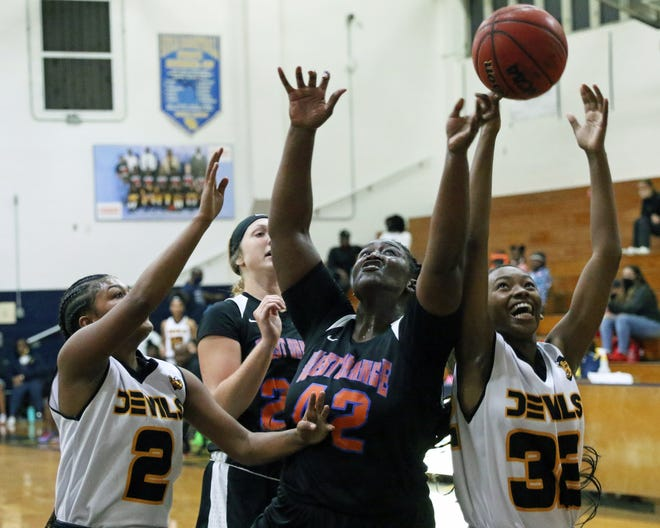 Winter Haven's Akiai Edouard (2) and Anovia Sheals (32) battle West Orange's Lakada Bryant for a rebound on Saturday night in the 11th annual Florida Prospects Thanksgiving Shootout.