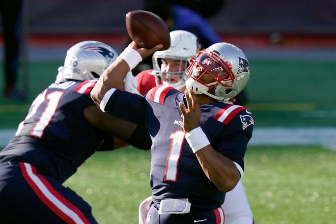 New England Patriots quarterback Cam Newton passes against the Arizona Cardinals in the first half on Sunday in Foxborough.