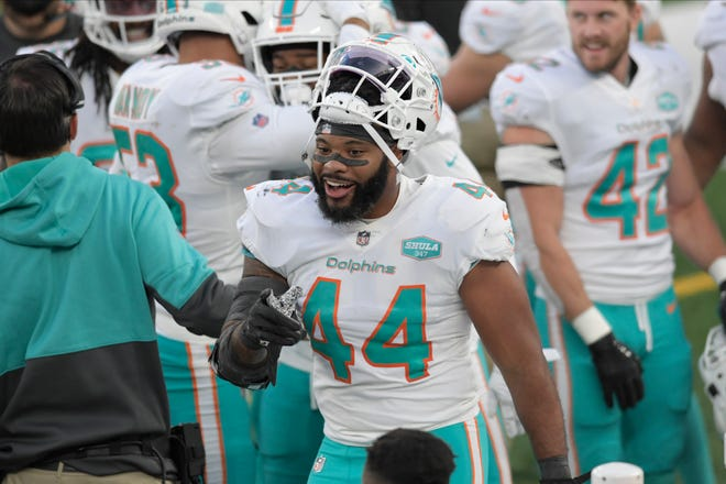 Miami Dolphins' Elandon Roberts reacts on the sidelines during the second half of an NFL football game against the New York Jets, Sunday, Nov. 29, 2020, in East Rutherford, N.J.