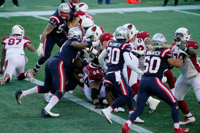 The New England Patriots make a goal line stand to stop Arizona Cardinals running back Kenyan Drake at the end of the first half of an NFL football game, Sunday, Nov. 29, 2020, in Foxborough, Mass.