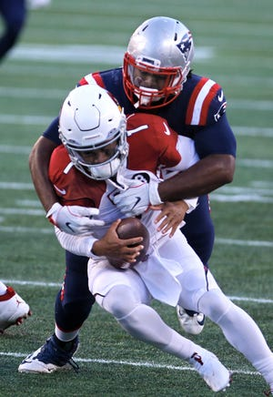 Adam Butler, shown sacking Cardinals quarterback Kyler Murray in the second half, and the New England defense made plenty of big plays Sunday, but none was bigger than the goal-line stand that closed out the first half in their 20-17 win.
