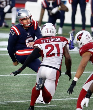 Patriots kicker Nick Folk follows his last second field goal attempt that gave the Patriots their 20-17 win over the Cardinals.