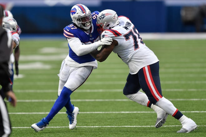 Buffalo Bills defensive end Mario Addison (97) works against New England Patriots' Isaiah Wynn (76) during the second half of an NFL football game Sunday, Nov. 1, 2020, in Orchard Park, N.Y.
