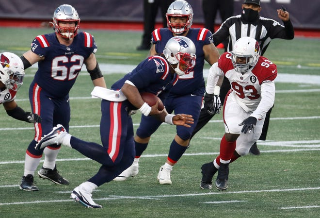 Cam Newton (shown in action earlier this season against Arizona) set two Patriots' quarterback rushing records with his 49-yard first-quarter run Sunday against the New York Jets.