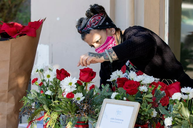 Julie Saccomanno, an employee of Stockton Floral, arranges the flowers during the Yosemite Street Village Small Business Saturday Nov. 28 in Stockton.