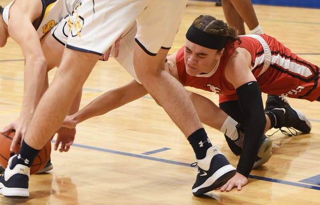 Jacob Gartner, shown diving for a loose ball against Streetsboro last season, led Field with 16 points Saturday.