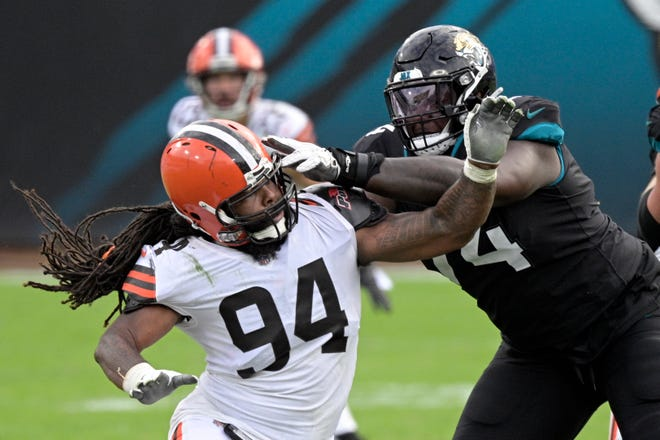 The Browns have released defensive end Adrian Clayborn. [Phelan M. Ebenhack/Associated Press]