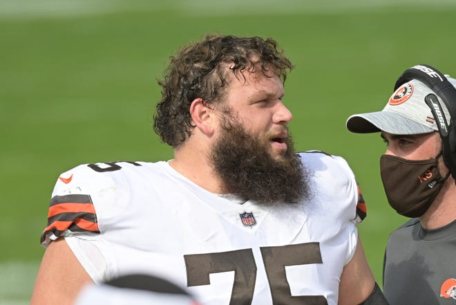 Browns guard Joel Bitonio on the sideline during the first half of a game against the Jaguars, Sunday, Nov. 29, 2020, in Jacksonville, Fla. (AP Photo/Phelan M. Ebenhack)