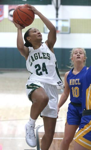 Breezie Williams (24) of GlenOak drives to the basket past Emily Foley (10) of Notre Dame-Cathedral Latin during their game at GlenOak on Saturday, Nov. 28, 2020.