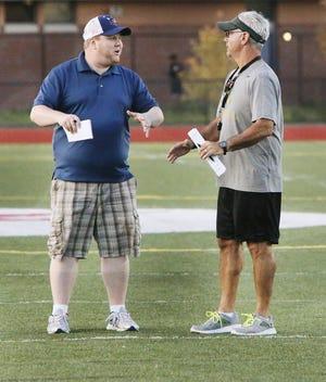 Brendan Kurie, left, talks with former GNB Voc-Tech football coach Chuck Allaire.