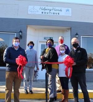 A ribbon cutting was recently held at the new location of Coastal Women's Shelter's Helping Hands Boutique. [CONTRIBUTED PHOTO]