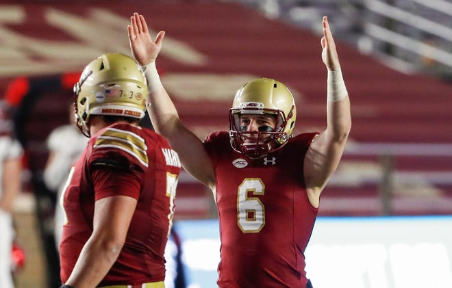 Boston College quarterback Dennis Grosel (6) celebrates after throwing a touchdown pass during the second half against Louisville.