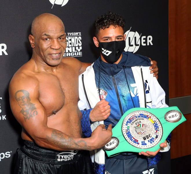 Mike Tyson, left, stands with Worcester's Jamaine Ortiz after Ortiz won the WBC USNBC silver lightweight championship following a knock out of Sulaiman Segawa on Saturday night.