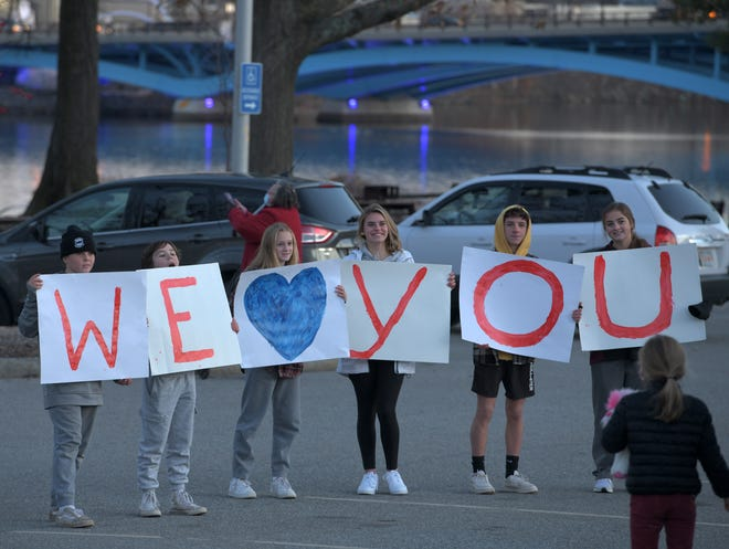 "WORCESTER - About 50 police cars and three fire trucks formed a parade at Regatta Point on Sunday in a show of support for Sterling Police Officer David Johnson, who is battling leukemia at UMass Memorial Medical Center - University Campus on Lake Avenue. Meanwhile, family and friends stood outside the hospital and connected by phone with Johnson, 55, and held signs spelling out, ""We love you""."