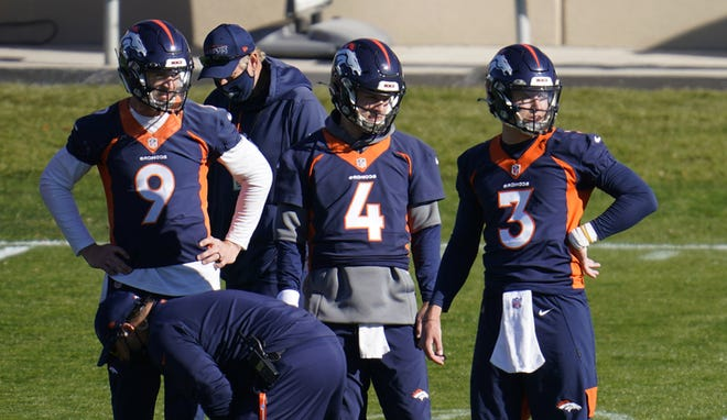 Broncos quarterbacks Drew Lock, Brett Rypien and Jeff Driskel, from right, watch during a practice earlier this month.