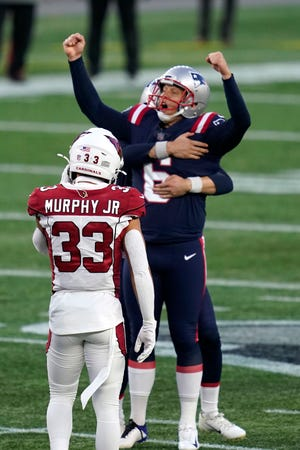 New England kicker Nick Folk celebrates his game-winning field goal as time expires during Sunday's game.