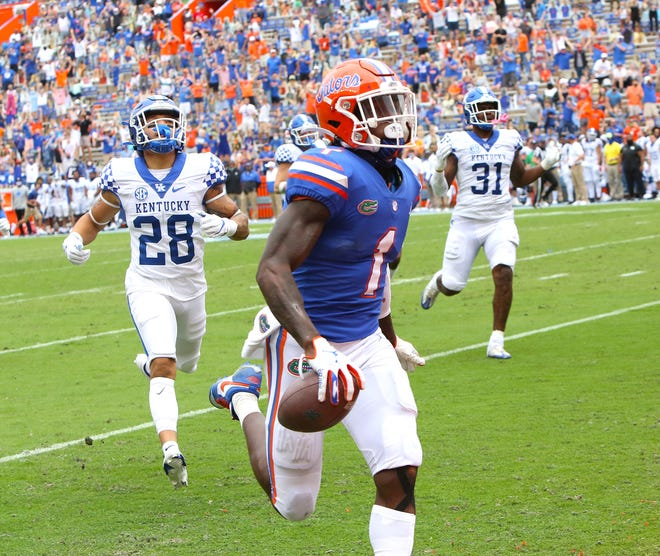 Florida's Kadarius Toney runs into the end zone with a 50-yard punt return Saturday against Kentucky at Ben Hill Griffin Stadium.